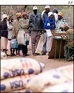 People queuing to receive food aid