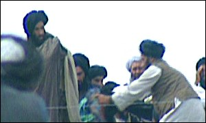 Mullah Omar [l] with followers in northern Afghanistan