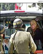 Palestinian woman is questioned by Israeli soldiers