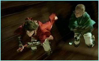 Harry and Draco battle it out during the Quidditch game
