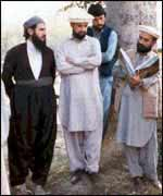 Mullah Krekar (left) with three other men