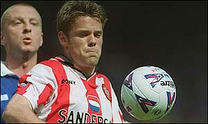 Southampton's James Beattie holds off Matt Elliott of Leicester City