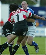 Richard Parks stops Bridgend captain Gareth Thomas in his tracks