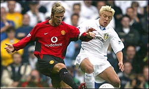 Beckham attempts a cross-field pass at Elland Road