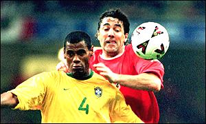 Dean Saunders battles for possession with Brazil's Aldair
