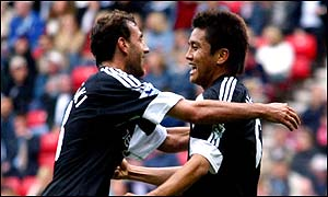 Inamoto is congratulated by Sylvain Legwinski