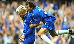 Gianfranco Zola embraces Eidhur Gudjohnsen after the opening goal