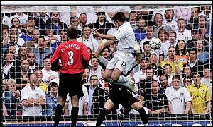 Leeds' Harry Kewell rises heigh to head home the winner