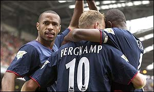 Thierry Henry is mobbed by his team-mates after putting Arsenal in front
