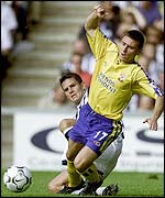 Southampton's Marian Pahars is tackled by Albion's Phil Gilchrist