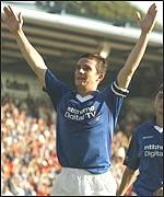 Barry Ferguson celebrates scoring the second goal