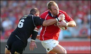 Scott Quinnell is tackled by Neath blindside Hywel Jenkins