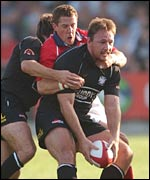 Neath No 8 Nathan Bonner-Evans holds off the challenge of Llanelli scrum-half Guy Easterby