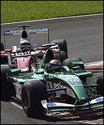 Eddie Irvine holds off Toyota's Allan McNish in the early laps at Monza