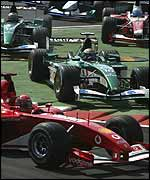 Eddie Irvine cuts across the first chicane at the start of the Italian Grand Prix