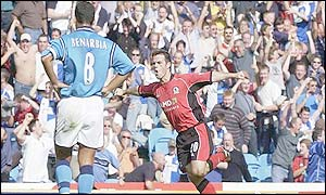 David Thompson celebrates scoring in the Lancashire derby
