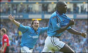 Shaun Goater (right) and Eyal Berkovic celebrate City's equaliser