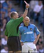 Danny Tiatto is shown the red card for a challenge on David Thompson