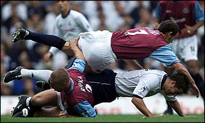 West Ham's Tomas Repka and Jamie Redknapp of Spurs clash