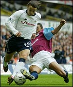 West Ham's Edouard Cisse tackles Simon Davies of Spurs
