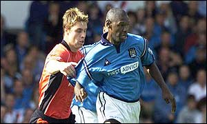 Gary Flitcroft tries to stop Manchester City's Shaun Goater in his tracks
