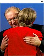 Goeran Persson hugs Party of the Left leader Gudrun Schyman