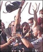 Prada hold aloft the Louis Vuitton Cup after beating AmericaOne in the last race of the Louis Vuitton finals