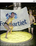 Liberal Party supporters celebrate in the Sergel Square fountain in central Stockholm
