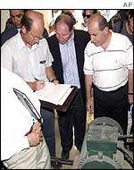 Jim Franckiewicz (left) inspects pumping station
