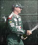 Eddie Irvine lets loose the champagne