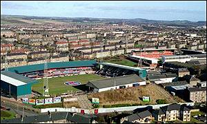Dens Park (left) and Tannadice currently share the same street