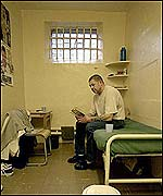 Inmate inside his cell