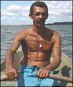Marciano rowing to the island where he lives