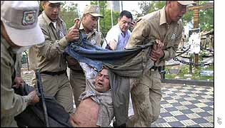 A protester is arrested and dragged away by police