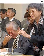 Shigeru Yokota (left) wails as his wife, Sakie, speaks in tears during a press conference in Tokyo after learning their daughter, Megumi, is confirmed dead