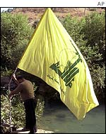 Hezbollah flag being planted on the Lebanese side of the Wazzani river