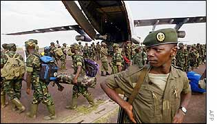 Troops board plane