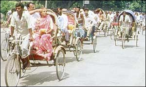 Row of cycle rickshaws on a Dhaka street