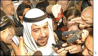 Acting oil minister for Kuwait surrounded by journalists