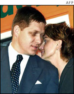 Robert Fico speaks with his deputy Monika Benova