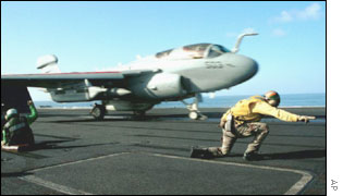 An EA-6B Prowler launches off a catapult from the flight deck of a US aircraft carrier