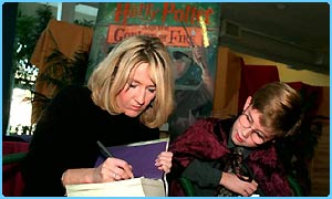 JK Rowling signing a book for a boy in New York