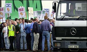 Protesters make their point outside the Asda depot