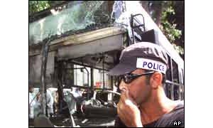Policeman by bombed bus