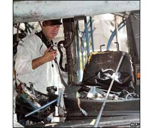 Security staff examine the driver's seat