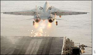 A US Navy F-14 takes off from an aircraft carrier