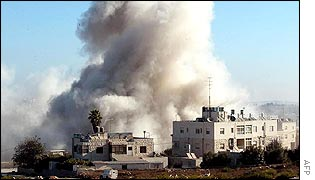 Smoke billows from Yasser Arafat's Ramallah compound