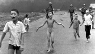 June 1972:Phan Thi Kim Phuc, centre, with her clothes torn off, flees with other South Vietnamese children after a misdirected aerial napalm attack on suspected Viet Cong hiding places