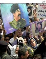 Crowd with poster of Saddam Hussein
