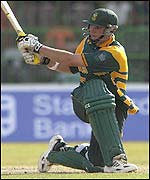 Graeme Smith goes for a slog-sweep